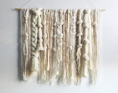 This is a hand woven wall hanging in a palette of creamy neutrals. The ends of the fringe are dip-dyed to a dark grey. Id be happy to dye the fringe any color youd like, just shoot me a note! The dowel is 24 inches wide, and the whole weaving measures 24x28 inches, including the fringe. It makes a beautiful gift for a housewarming, birthday, or wedding. This weaving is made to order (~2 weeks) and comes with the dowel, ready to hang. Made by hand on a frame loom. Please contact me with...