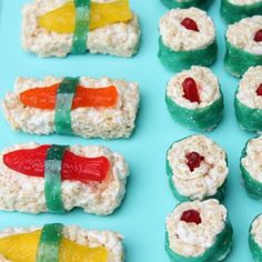 """Dessert sushi -- perfect for an """"under the sea"""" party!  Just Rice Krispy treats with Swedish fish and fruit roll-ups for the seaweed."""