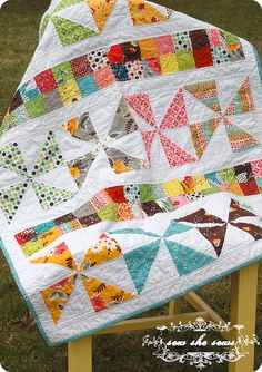 Pinwheel & Postage Stamp quilt - great idea for a row quilt