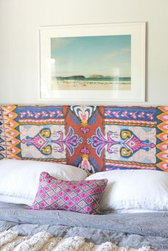 No money to reupholster your headboard? No problem! Amber Lewis draped a patterned scarf on an old headboar...