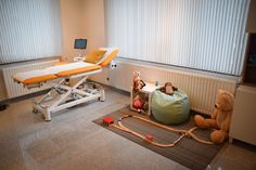 Midwife practice, medical office, ultrasound, examiation table, play corner for kids.