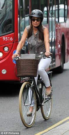 Her basket on her bike made room for a stylish clutch...