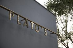 cut bronze letters on a rail Shop Signage, Office Signage, Retail Signage, Wayfinding Signage, Signage Design, Environmental Graphic Design, Environmental Graphics, Industrial Signage, Wc Sign