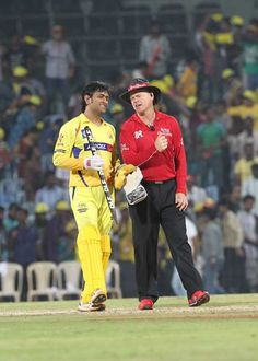 Chennai Super Kings captain MS Dhoni (L) walks beside the umpire during the IPL Twenty20 cricket match between Chennai Super Kings and Deccan Charges  at The M.A.Chidambaram Stadium in Chennai on May 4, 2012.