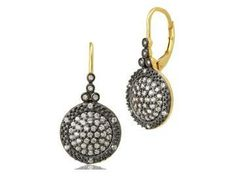 Two tone reverse small times square leverback earrings with clear and black stones. The earrings are in oxidized sterling silver and fourteen karat gold plated earrings. Designer:Freida Rothman $ 175.00 Item #: NLNCAA Call 870-863-8818 for personal consultation.