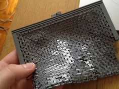 A printable clutch (purse, evening bag, etc) for desktop 3D printers.  I've been a big fan of Zomboe's things, and have been eyeing his chainmail designs since I bought my TOM last year.  There are lots of 3D printed fabric applications for pro-grade printers on shape ways, etc, but not for use on reprap or makerbot style printers.  Building some awesome and wearable feminine accessories has been on my to do list for awhile.   Goals:     Functional purse that will hold an iphone.     Print…