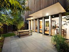 Modern Outdoor Fireplace Designs With Concrete Floor Completed With Simple Rectangular Table And Benches For Sitting And Dining Modern Outdoor Fireplace, Outdoor Fireplace Designs, Outdoor Living, Outdoor Decor, Modern Patio, Melbourne Suburbs, Melbourne House, Outdoor Flooring Options, Terrasse Design