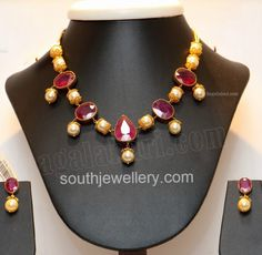 Necklace studded with large rubies and south sea pearls, paired up with matching earrings by RR Jewellers, Hyderabad. Related PostsLight Weight Ruby South Sea Pearl NecklaceSouth Sea Pearls and Emerald NecklaceAntique Necklace With Elephant PendantBeautiful Polki NecklaceSouth Sea Pearls Necklace with Uncut Diamond Pendant SetEmerald Ruby Necklace
