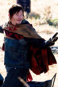 A COMPLETELY  ADORABLE NORMAN REEDUS EXPRESSION - BETWEEN FILMING ON SEASON 3. (THE FAMOUS PONCHO FIRST MADE ITS APPEARANCE IN SEASON 3)