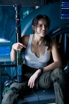 Michelle Rodriguez for the Expendabelles. Maybe if Vin Diesel is working with expendables, then she could be his love interest like in the fast and furious movies. Badass Aesthetic, Bad Girl Aesthetic, Poses, Mädchen In Uniform, Man In Black, Military Women, Warrior Girl, Badass Women, Fast And Furious