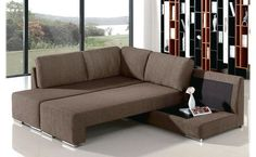 Sofa Brown Color With A Very Nice And Beautiful Modern Design, With A Few Cushions On The Sofa, And In Addition There Is Also A Sofa Table Lamp Good