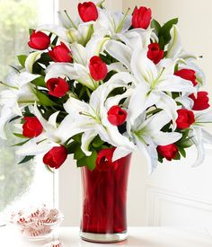 red tulip and white lily bouquet