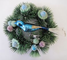 Vintage Christmas Ornament Glass Bird teamed up with a vintage Christmas candle holder.