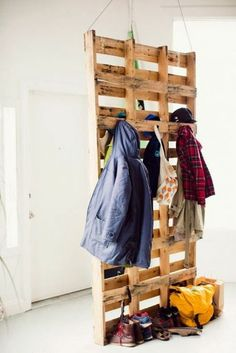 Pallet Coat Storage :: pallets suspended from the ceiling to create a coat storage and room divider.I might like something like this in the garage. by annabelle Metal Room Divider, Bamboo Room Divider, Bed Divider, Attic Renovation, Attic Remodel, Wooden Pallet Furniture, Wooden Pallets, Euro Pallets, Antique Furniture
