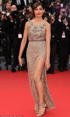 Thighs the limit: Frieda Pinto wears a Gatsby-esque golden dress with a revealing slit to the Jeune & Jolie premiere