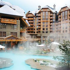 The Four Seasons Whistler - Beautiful hotel, love the outdoor pools with snow cap mountains in the background! #dreamwintervaca