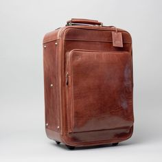 afe9e32ef9 The Piazzale Wheeled Leather Trolley Case Short Vacation