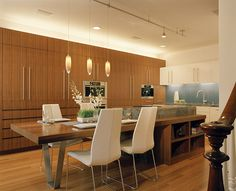 dining table integrated into island in front of galley kitchen