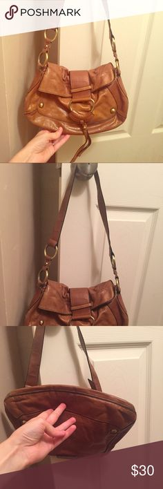 Sabina cognac leather bag Sabina cognac leather bag. small/medium size. Well loved with still a lot of life...good used condition. I have really enjoyed the uniqueness of this piece. I bought it in Nashville, Tennessee a few years ago. Sabina Bags Shoulder Bags