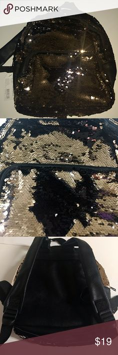 "Color-changing sequined mini backpack Beautiful sequins change from hot pink or gold to black with a simple swipe of hand.  Two separate zippered compartments to help organize items. 10"" from side to side, 3.5"" from front to back and 11"" tall. Front zippered pouch is 7"" tall. Additional zippered pocket and two pockets inside fully-lined main compartment. Faux leather back with 2 fully adjustable straps. NWT, smoke free home. Price is PER bag. office Depot Bags Backpacks"