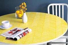 a finished table with a herringbone pattern combed onto it in yellow via TOH