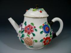 Antique Chinese Famille Rose Carved Porcelain Teapot, 18th / 19th Century. Ht: 5 inches.