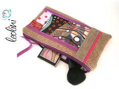 Aus Walkloden gefertigtes Täschchen, es kann als Schminktäschchen und auch als Federmäppchen verwendet werden.