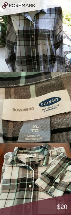"""Oversized Old Navy Boyfriend Button Front Shirt This is a thin super cute oversized plaid shirt. Could easily fit up to a 2x. It's black and white with mint accents. Perfect over leggings.   Approx 24.5"""" across the bust, laid flat arm pit to arm pit.  28"""" long in front and 30"""" long in back. 100% cotton   Bundle discount available. Nonsmoking home. All reasonable offers accepted. Old Navy Tops Button Down Shirts"""