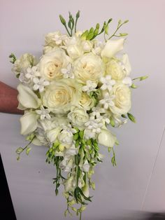 Cascading bouquet of roses, stephanotis, calla lilies, lysianthus, freesia and dendrobium orchids.  Just what the bride ordered!!!