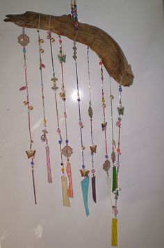 I recently put together a rather pretty hanger/wind chime for the patio using lots of leftover beads, old odd earrings, bits of old brooches and necklaces, and some colored glass pieces from a broken wind chime.