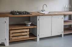 A German version of the British custom kitchen company Plain English? Spotted in Berlin last week, the work of Noodles, Noodles & Noodles Corp., a line of finely crafted, industrial-inspired furnishings, including this steel-and-wood kitchen.