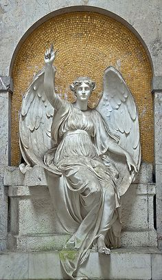 Golden angel - One of the best preserved figures in the crypt gallery (Gruftenweg) at the main cemetery in Frankfurt am Main, Germany.
