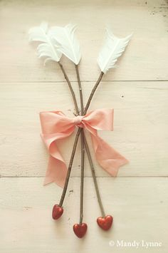 Adorable idea for making cupid arrows! This photographer has a stunning portfolio!