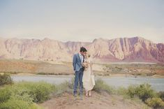 the beautiful landscape of Snow Canyon in Utah provides the perfect setting for these wedding portraits