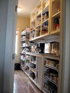 Large walk-in pantry with variety of shelving