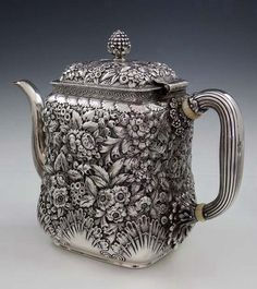 Tiffany & Co sterling silver teapot in a floral repoussé pattern, with a shell motif around the base. c1881