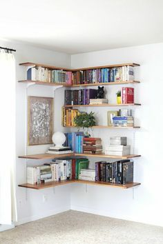 DIY Wall-Mounted Shelving Systems Easy to Install One of my favorite small space hacks is swapping your bookcases for wall-mounted shelving. We've created roundups of wall mounted shelving systems before, but for those of you who are especially crafty t Design Ikea, Diy Design, Design Trends, Sweet Home, Diy Casa, Wall Mounted Shelves, Wood Shelf, Diy Wall Shelves, Ikea Shelves