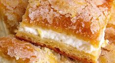Lemon cream cheese bars are a variation of the traditional lemon bars, made with crescent roll dough and a lemony cream cheese filling. Pumpkin Crunch Cake, Pumpkin Cake Recipes, Easy Cookie Recipes, Dessert Recipes, Simple Recipes, Cupcake Recipes, Dessert Ideas, Lemon Cream Cheese Bars, Low Fat Cream Cheese