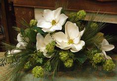 This elegant faux magnolia centerpiece makes quite a statement! Large, bold…