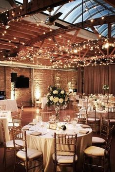 Indoor winter wedding reception with twinkly lights and classic wedding decor. Loft on Lake Weddings--brick and warm oak timber, ceilings, and a long skylight, what is there to not love? winter wedding Loft on Lake Loft Wedding Reception, Wedding Spot, Perfect Wedding, Dream Wedding, Trendy Wedding, Rooftop Wedding, Wedding Flowers, Wedding Table, Wedding Cakes