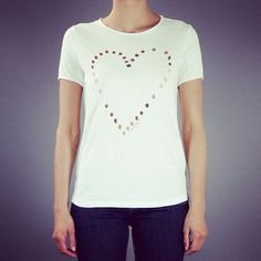 So romantic white cotton t-shirt from Golden Goose feat. a perforated heart design to the front and short sleeves