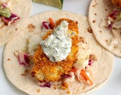 "Crispy cauliflower ""filet"" over slaw on a tortilla and topped with dairy free tartar sauce."