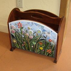 This is a very solid (and quite heavy) wooden magazine rack that I saw at a church sale and snatched up. After sanding down all of the surfaces, in Pebble Mosaic, Mosaic Diy, Mosaic Garden, Mosaic Crafts, Mosaic Projects, Mosaic Glass, Stained Glass, Glass Art, Mosaic Designs