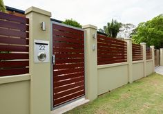 EstateWall - 1500mm high incorporating timber grain infills and custom pedestrian Gate with a digital lock.
