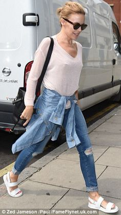 Step up: With her denim shirt tied loosely around her waist, and flat bright white sandals...