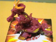 Bakugan B2 BakuTriad LOOSE Single Figure Pyrus Nova 12 Red Battalix Dragonoid 770 G by Spin Master. $7.59. Sold Loose-No Cards-No DNA. Bakugan battle brawlers are here! Answer the call to brawl and decide the fate of the galaxy! Magnetic marbles POP open into power Bakugan warrior action figures when they roll onto the real metal Gate Cards! Use strategy to place your metal Gate Cards as each card affects the battle differently. Master your shooting skills to r...