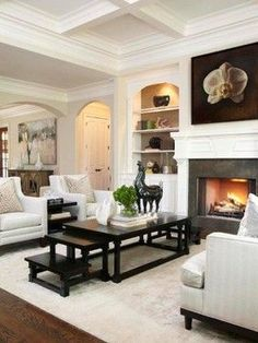 White living room with black accents. Do not like the artwork.