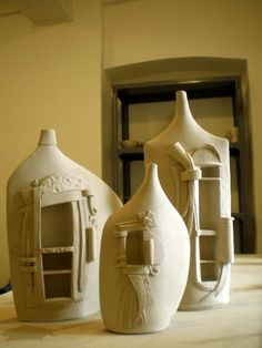 Clay over detergent bottles, this is air dry clay or paper clay