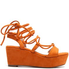 Orange low platform with laces that tie on the ankle.