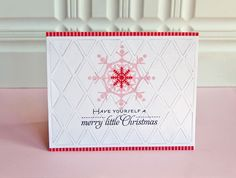 Use the Hexagon Die with Patterened Papers and then use felt die cut snowflakes